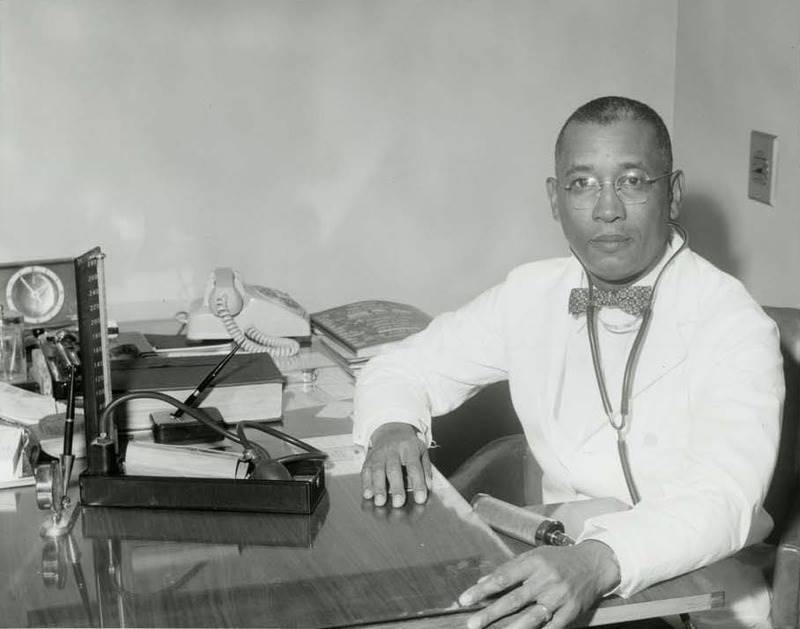 African-American at a desk working in early 1900's